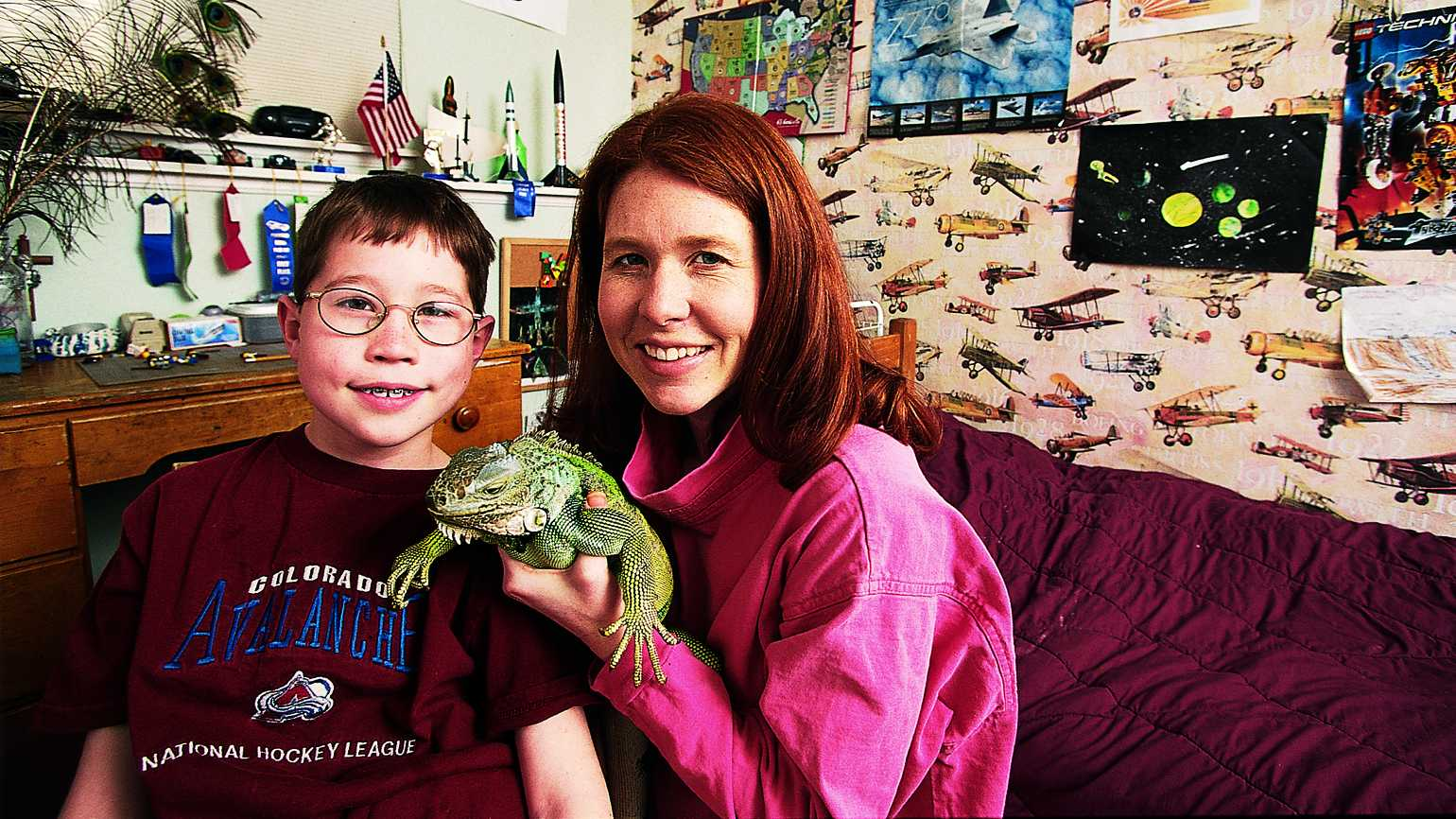 Max and his mother with his iguana, Bill in a no longer messy bedroom.