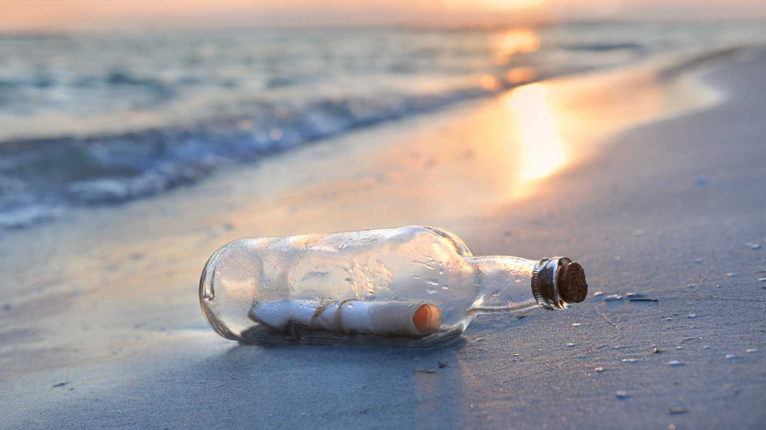 A message in a bottle on the beach.
