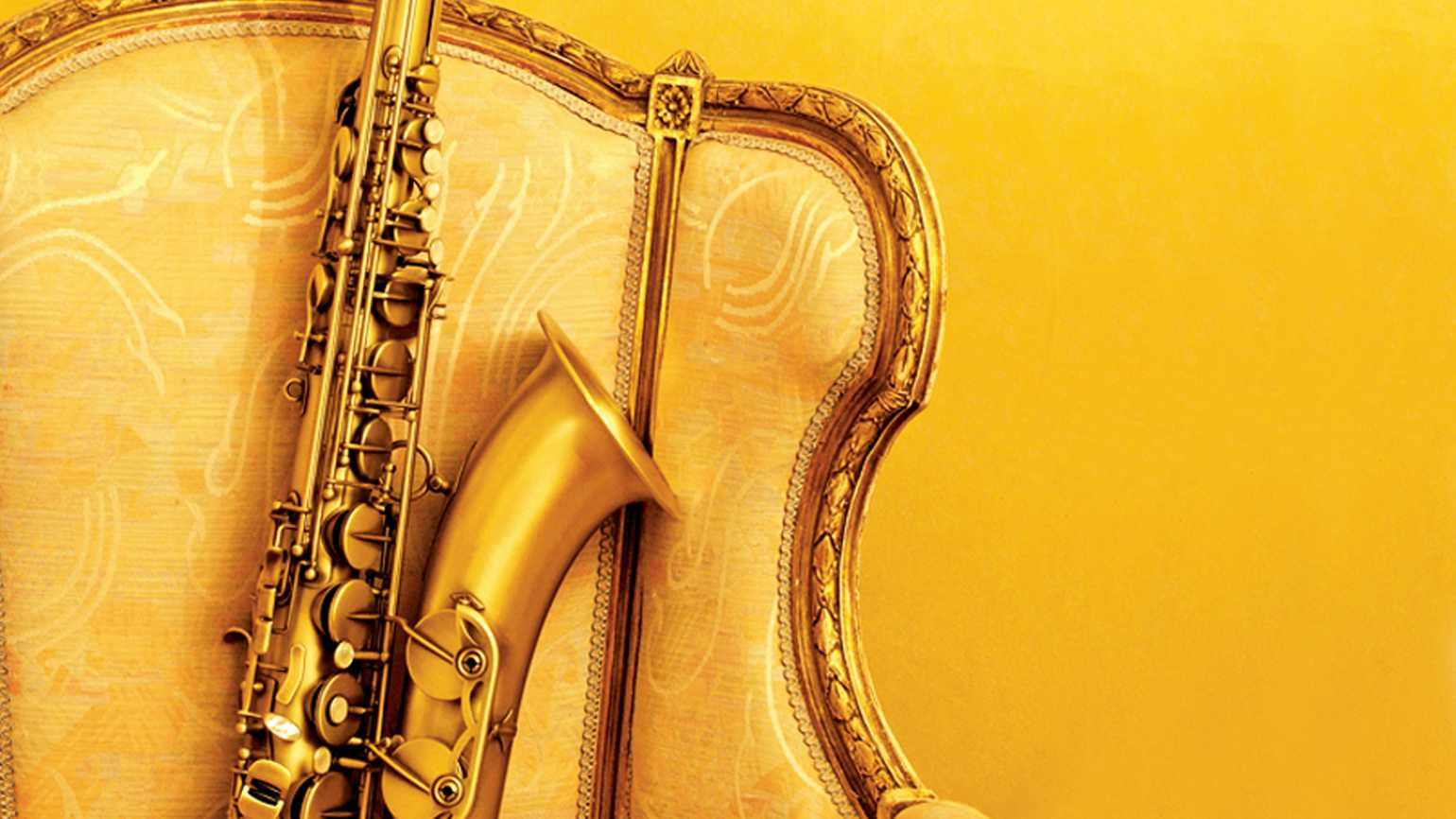 A heavy saxophone in a brilliant gold chair.