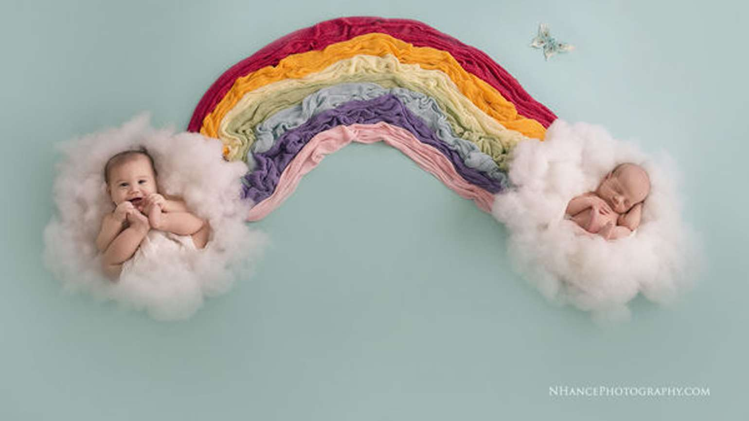 Evans and Whitten lay on clouds in their rainbow babies photo shoot