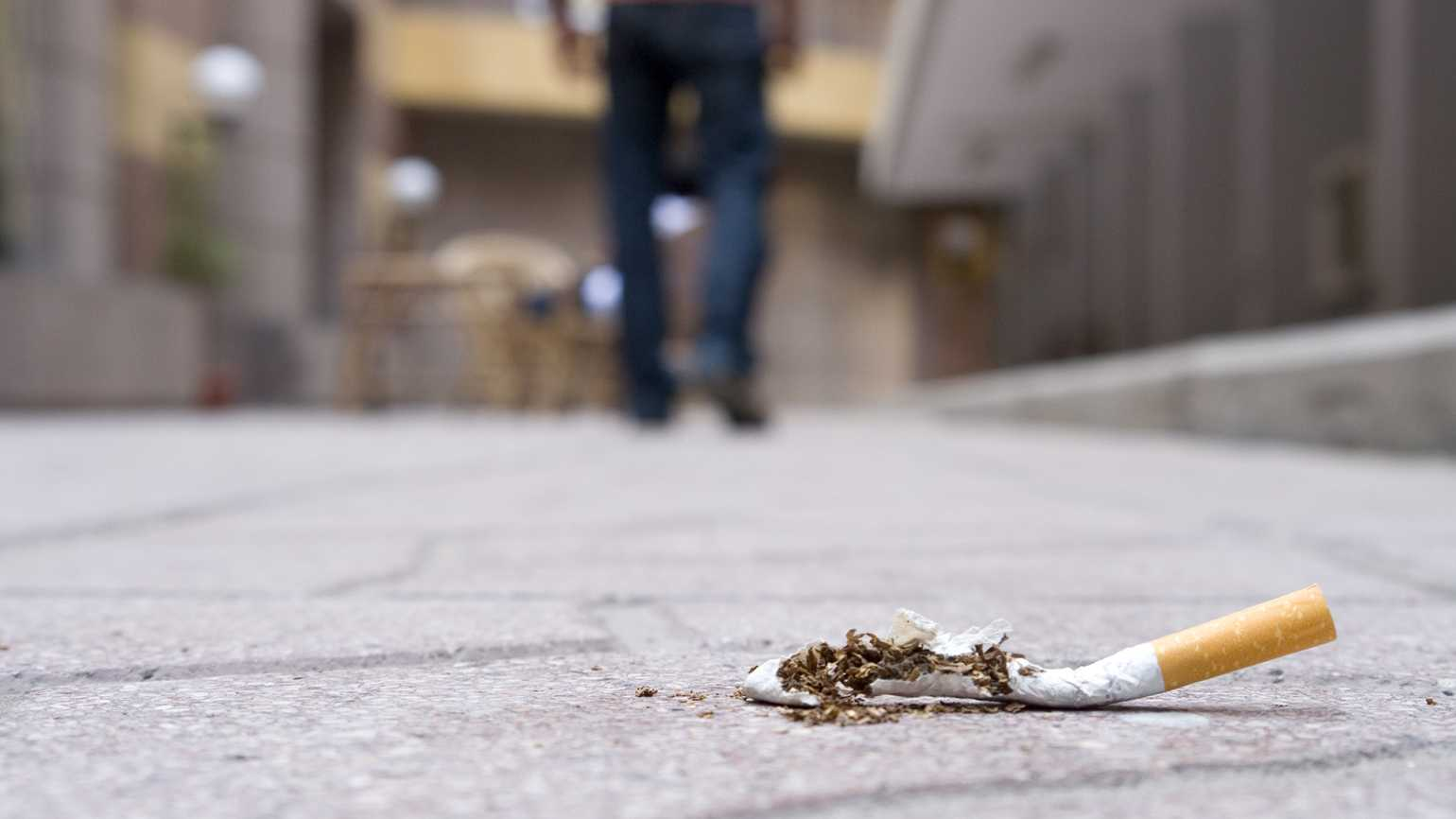 A man walking away from cigarettes.