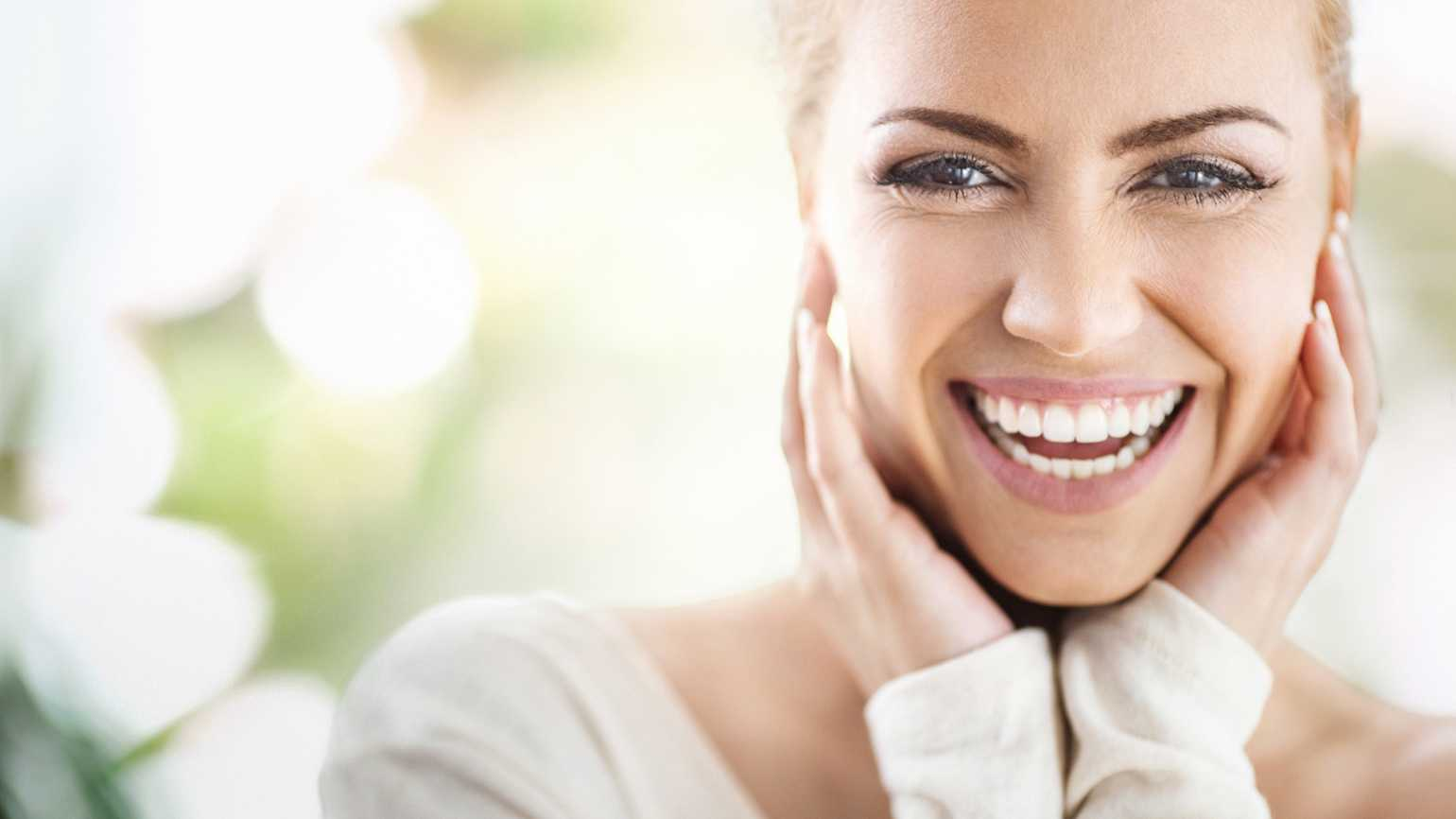 Close up of a woman laughing.