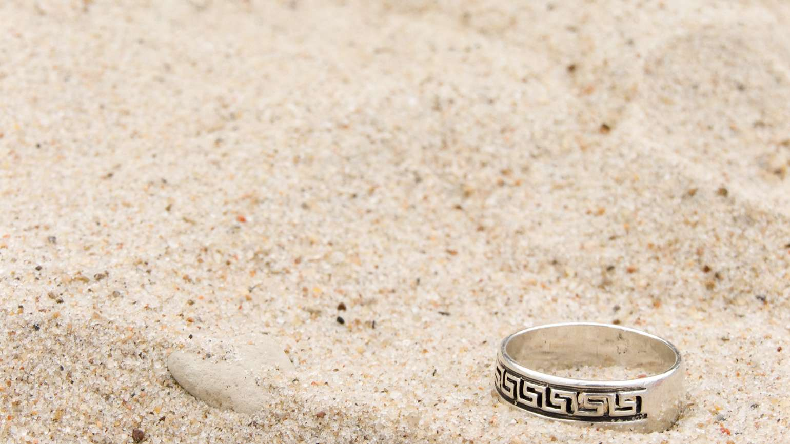 A wedding band on the sand.