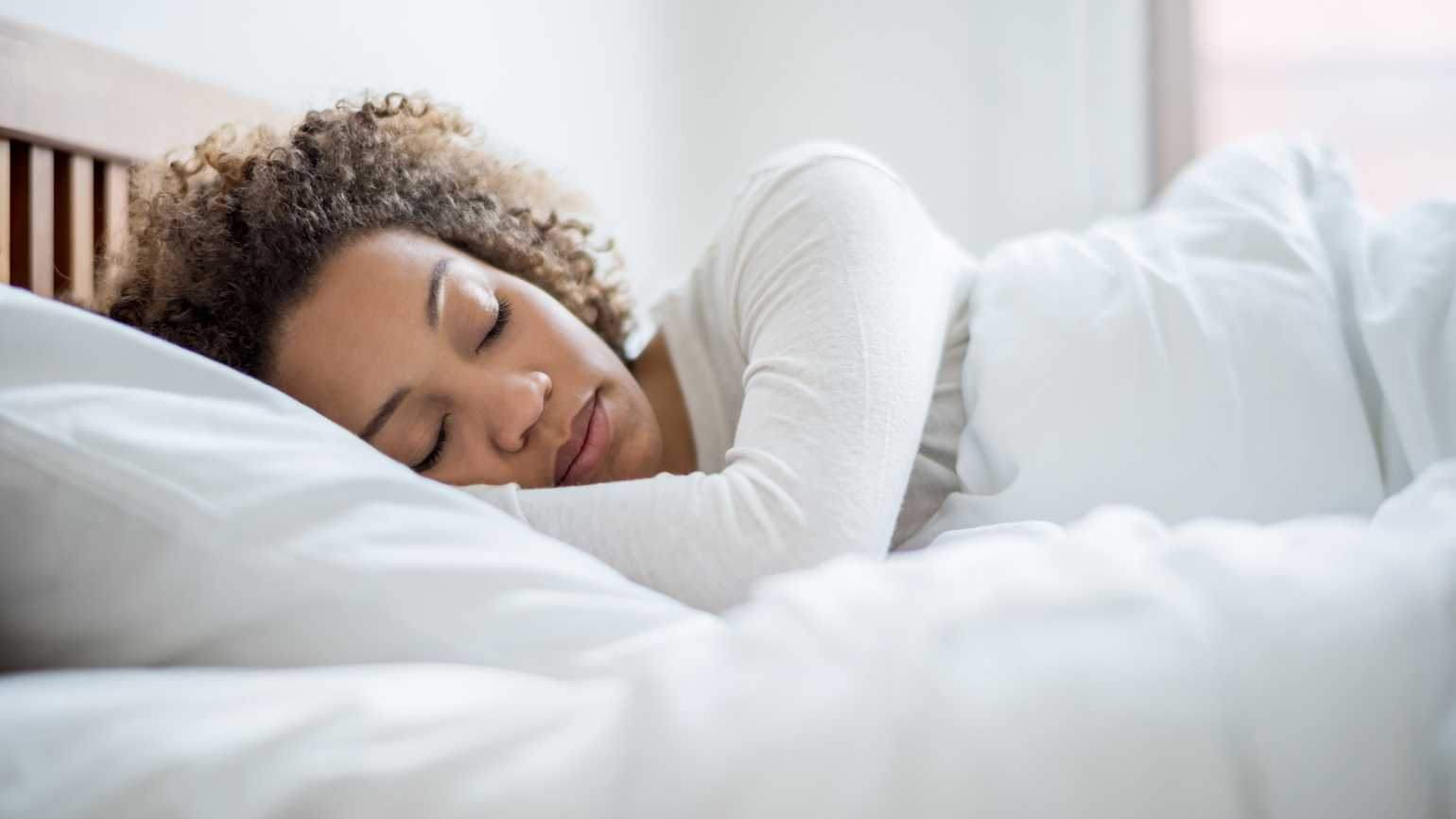 An African-American woman catching up on beauty sleep.