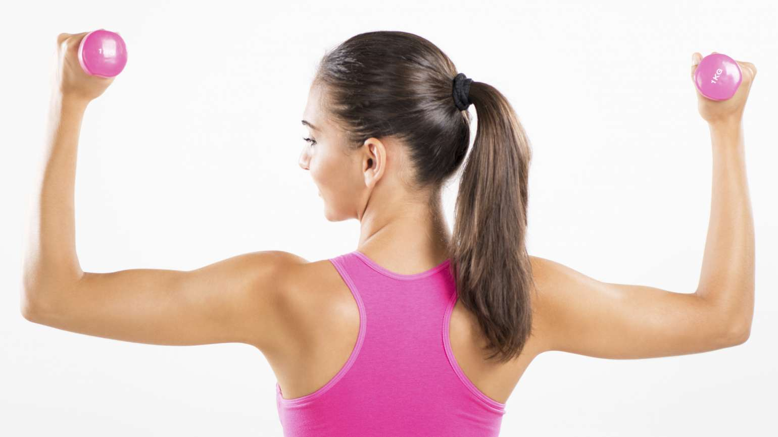 woman wearing pink workout clothes and flexing her arms with pink weights