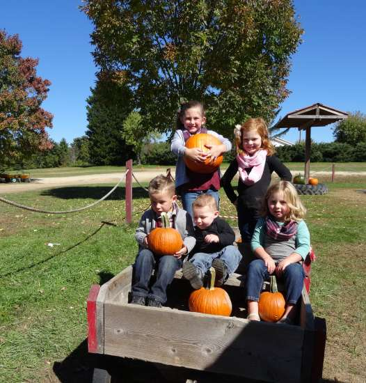 A pumpkin cart proved a perfect photo op for Michelle's five grandkids.