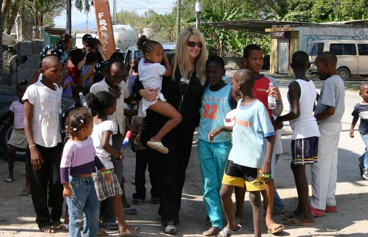 Shelene strolls with a group of children in the Dominican Republic.