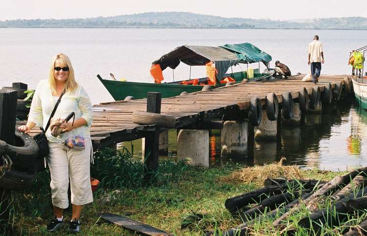 Shelene Bryan waits by a boat dock during her first trip to Uganda in 2003.