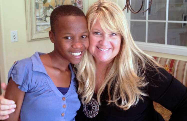 Shelene (right) and the child she sponsored, Omega, at Shelene's home in Los Angeles