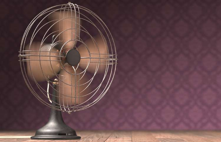 A vintage fan stirring up a breeze at Grandma's house