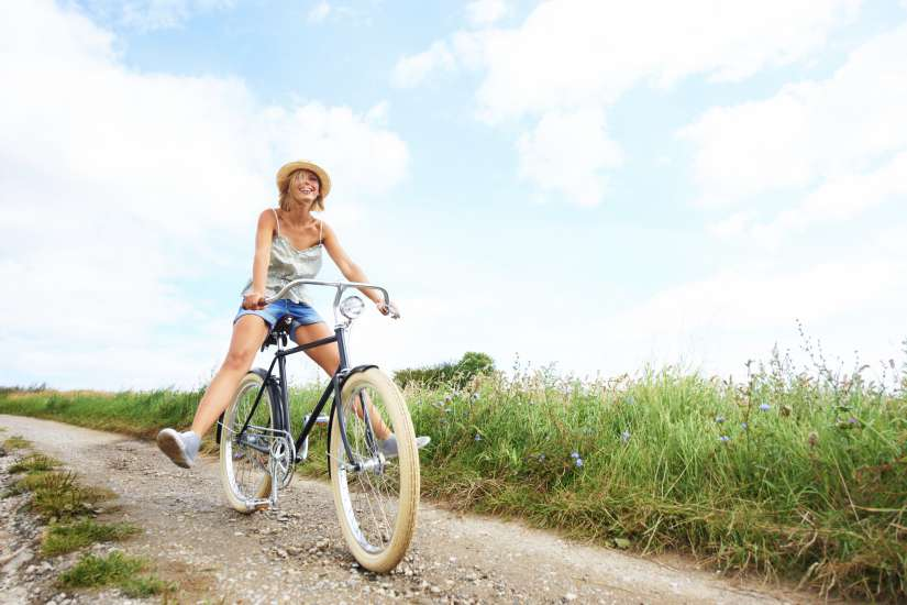 Girl finding happiness while riding bike