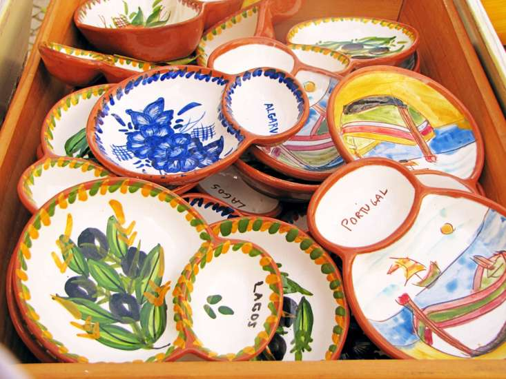 Many family-run shops demonstrate how azulejos, the hand-painted tiles for which Portugal is famous, are made.