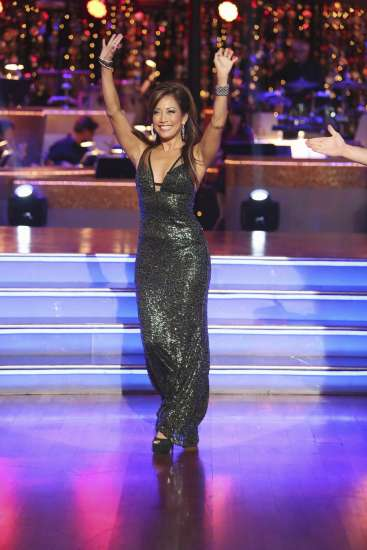 Carrie Ann Inaba waves to the audience from the set of Dancing with the Stars