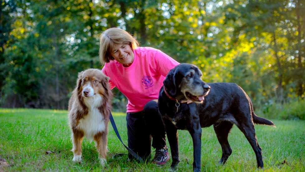 Amy's doggie family helped her through her grief after losing her beloved Kelly (left).