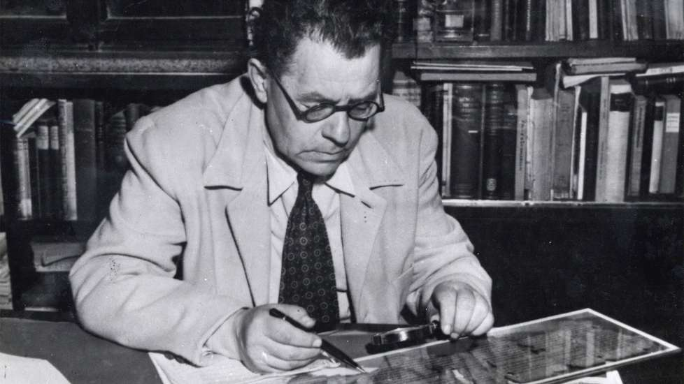 Scholar Eleazar Sukenik examining one of the Dead Sea Scrolls in 1951