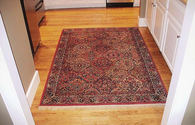 Janis's antique Persian rug, which was shifting in the night without anyone having walked on it