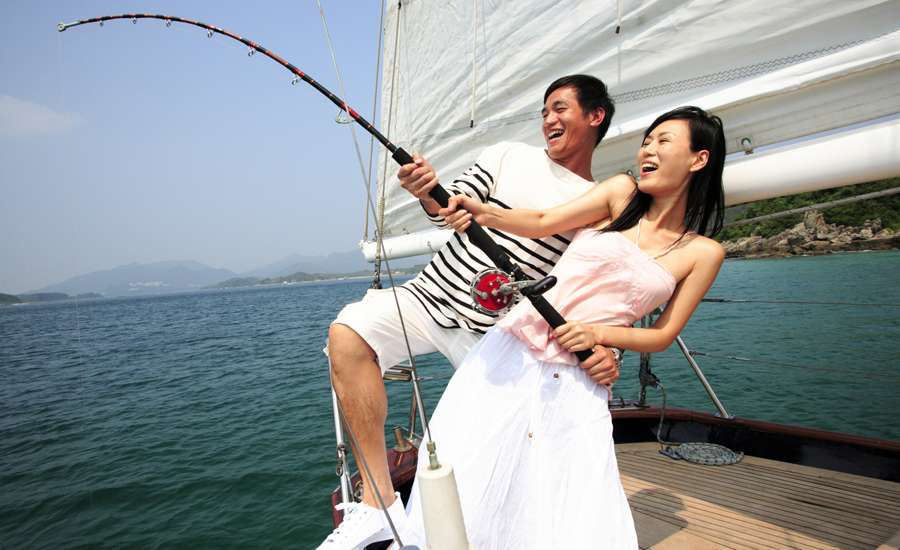 man and woman fishing on a boat