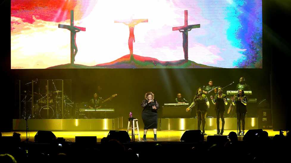 "Tamela Mann performs on stage during the ""Us Against The World"" tour."
