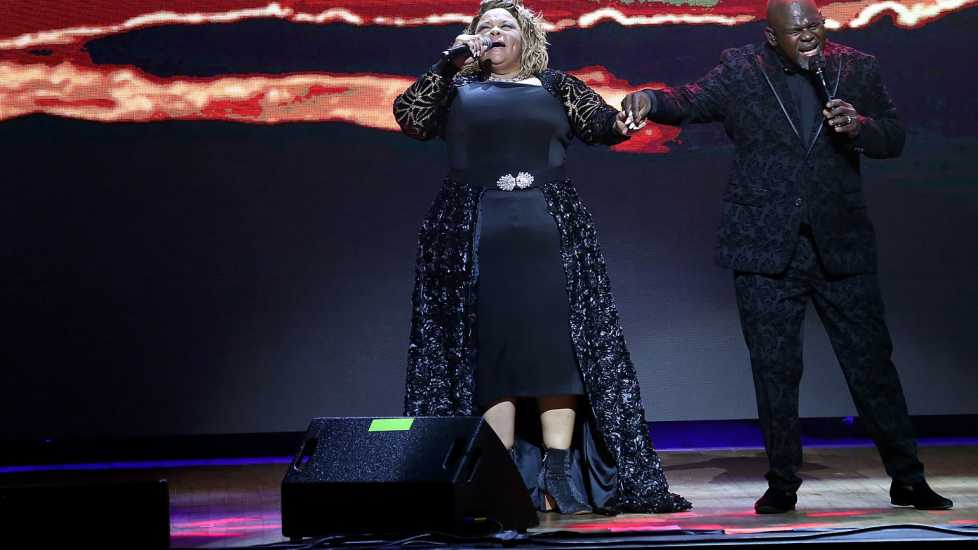 "David and Tamela perform during their ""Us Against The World' tour."