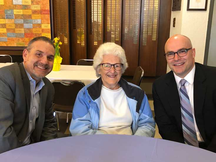 Pablo Diaz and Guideposts President and CEO John Temple spend some time with one of the event's attendees.