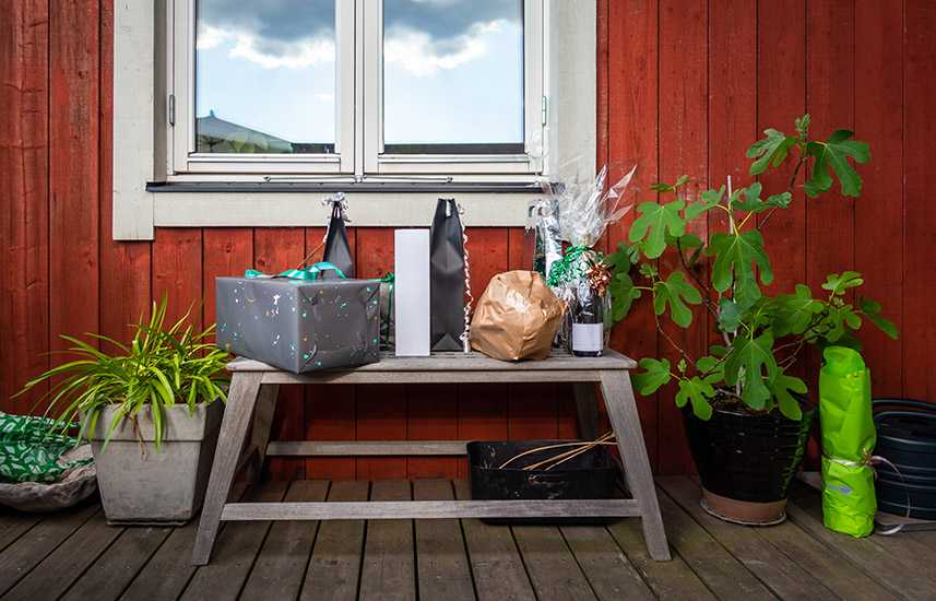 Gifts on a bench on a front porch