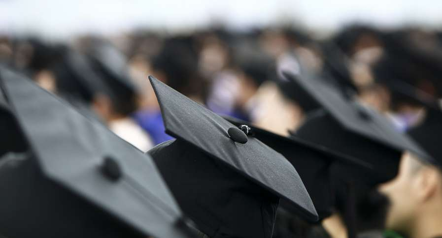 A crowd of graduates at a commencement ceremony