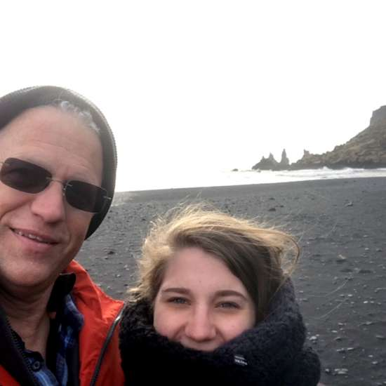 Alikay and her father on Reynisfjara, a black sand beach