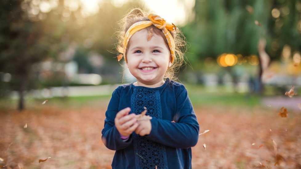 A young girl smiling during the Autumn season. Looking at my kids: Mysterious Ways Editors Share what makes them feel awe inspiration miracles gods grace