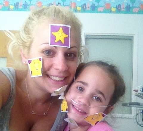 Char Magdits and daughter Ella with Comfort Kit stickers