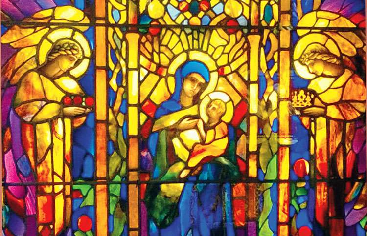 A photograph of Mary and Baby Jeus with a pair of angels taken at Smith Museum of Stained Glass Windows