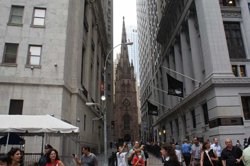 Trinity Church peeks out from between the office towers of Wall Street