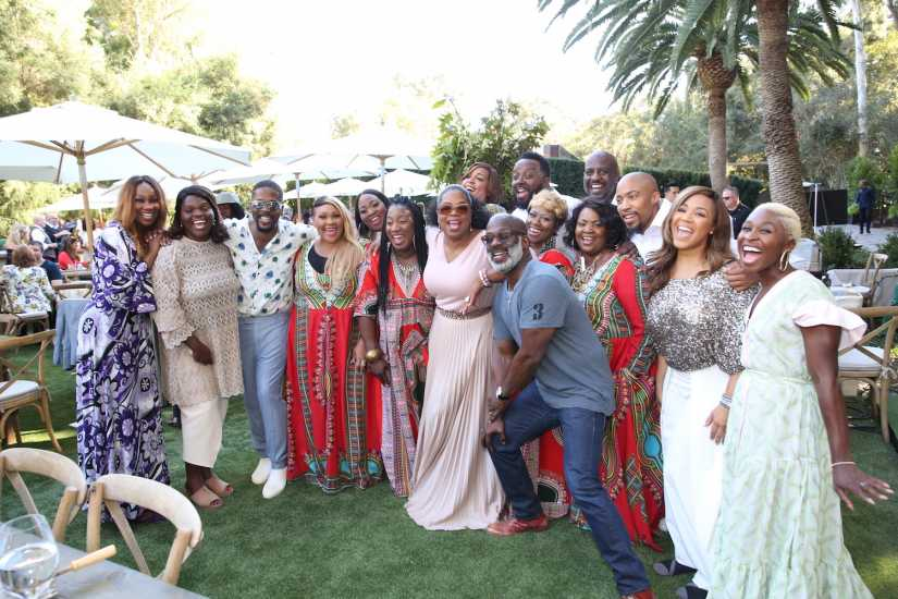 (L to R) Erica Campbell, Bebe Winans, Emily David, Oprah Winfrey, Cynthia Erivo, Yolanda Adams, Andra Day and Common