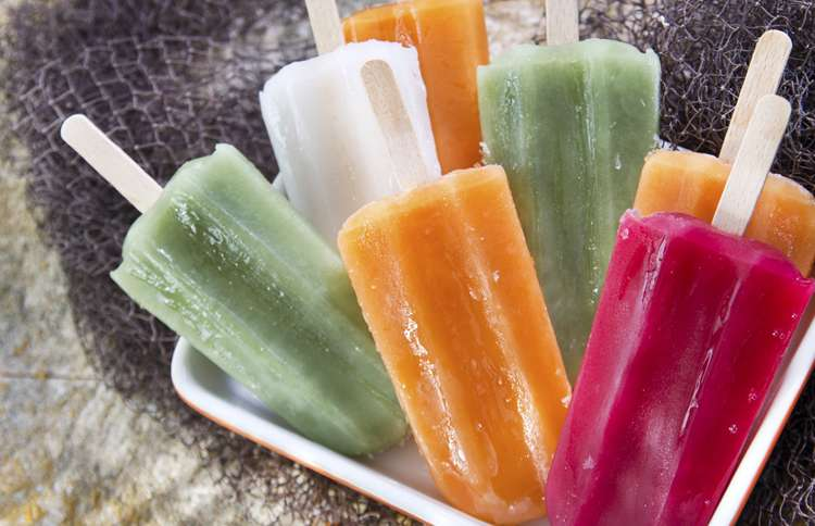 An assortment of refreshing, delicious popsicles in a variety of colors