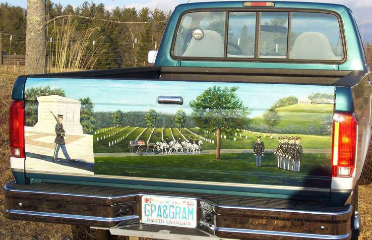 The tailgate of Charlie's truck, now emblazoned with Andrea's painting of Arlington Cemetery
