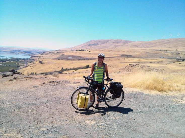 Deborah takes in the scenery from a spot overlooking the Columbia River Gorge near Maryhill, Washington.
