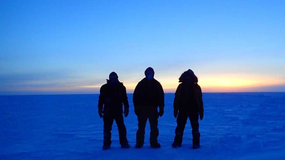 Silhouettes of Brett and his team in the South Pole.