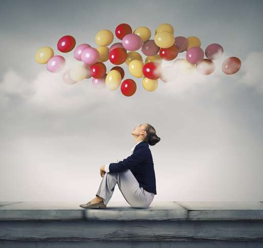 Guideposts: A woman gazes up at multicolored balloons floating in the air