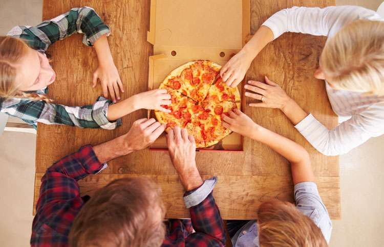 Every member of the family reaches for a slice of pizza