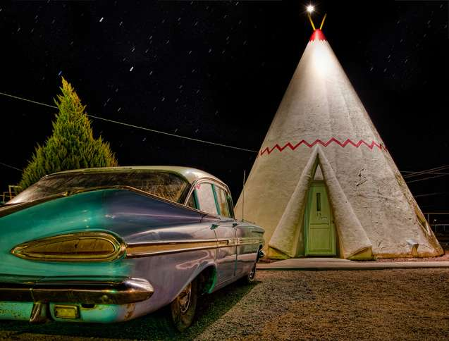 Guideposts: A vintage car parked outside one of the wigwam rooms at the Wigwam Motel in Holbrook, Arizona
