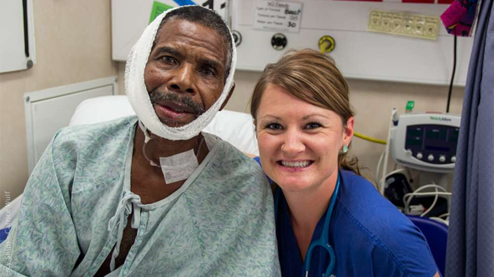Heather poses with William, one of her patients, who taught her a lesson about healing