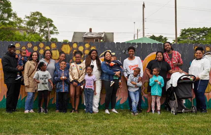 Timoth and Nicole with members of their community