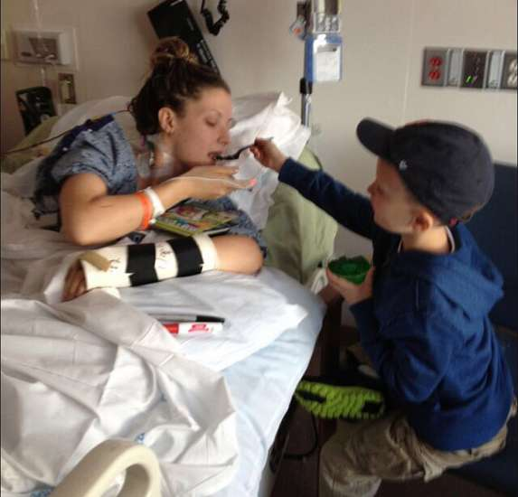 Rebekah's son, Noah, at her side in the hospital