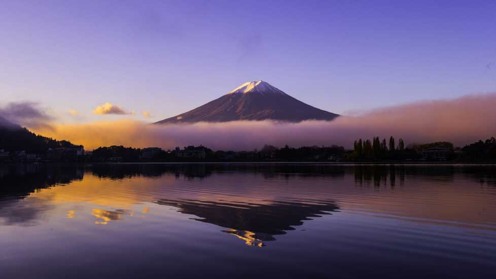 A mountain being reflected onto a lake.