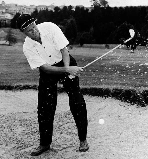 Graham blasts out of a sand trap on the Riversdale golf course in Victoria, Australia, on March 4, 1959.