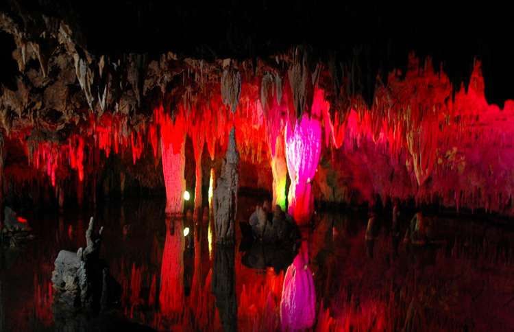 Guideposts: Colored lights illuminate the rock formations of Meramec Caverns in Stanton, Missouri