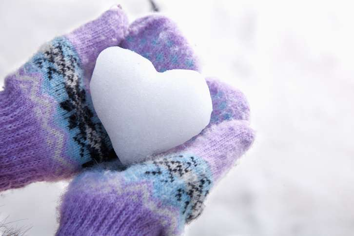 Guideposts: Mittened hands hold a snowball in the shape of a heart