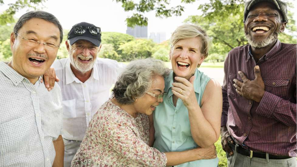 A group of senior citizens share a laugh together