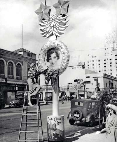 Guideposts: Claudette Colbert admires her oversized portrait lining Vine Street in Hollywood for the 1932 Santa Claus Lane shopping season.