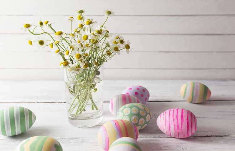 Guideposts: a vase of wild flowers surrounded by brightly colored Easter eggs