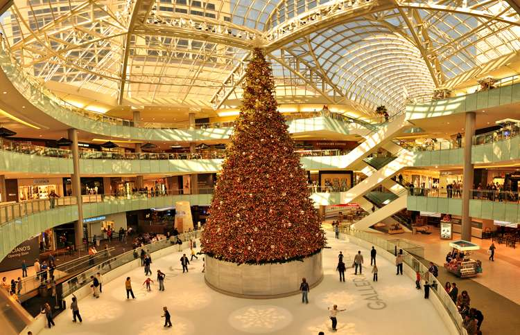 Guideposts: The Galleria Dallas tree, which weighs five tons, towers four stories above the Galleria's ice-skating rink and is topped by a 10-foot star illuminated by LED lights.